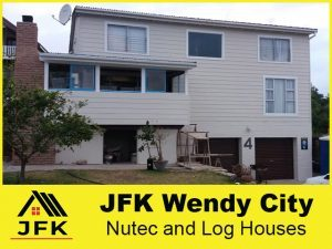 JFK-Nutec-and-Log-Houses